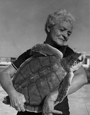 Ila Fox Loetscher Holding Turtle